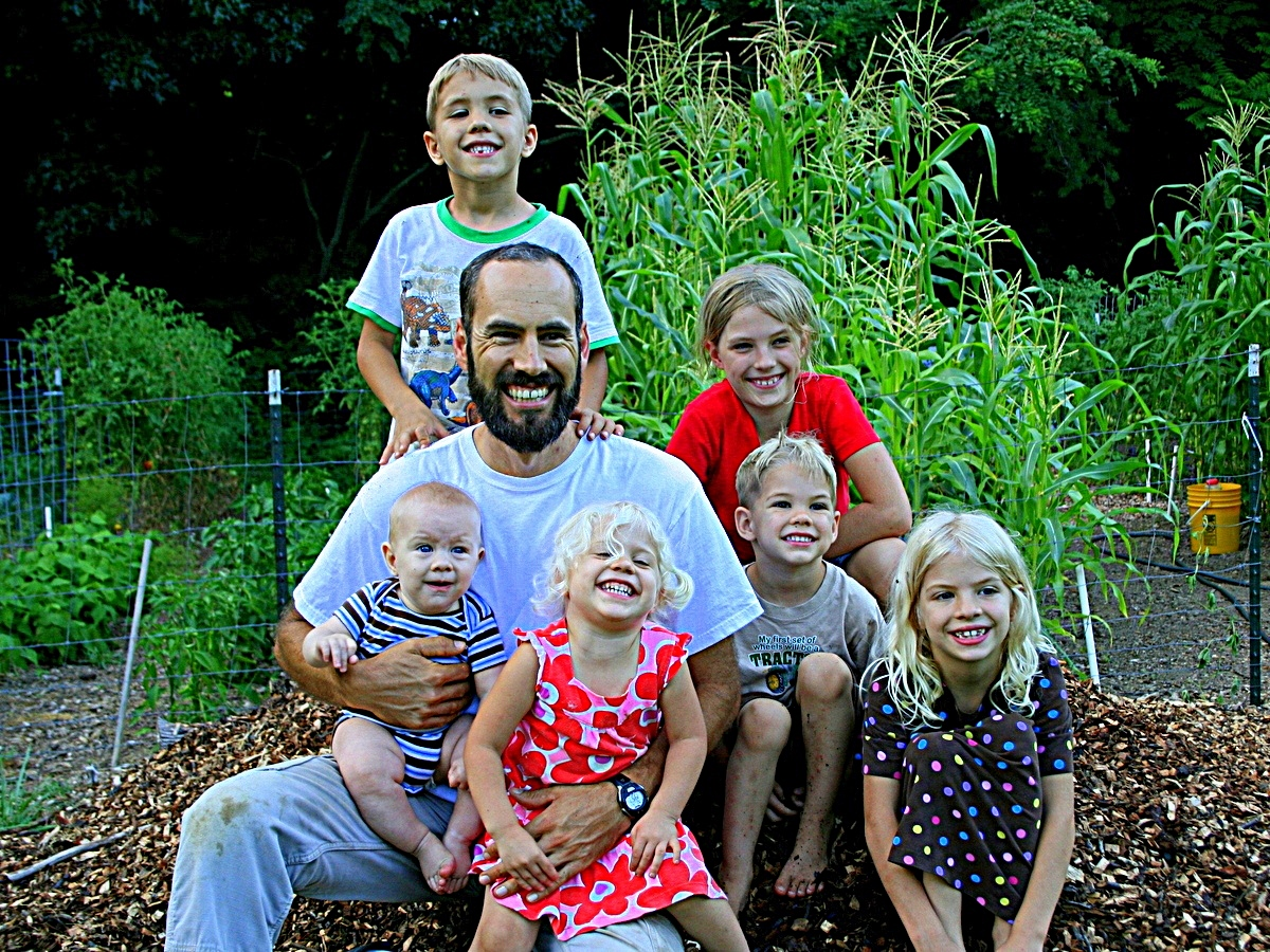 Jason and the kids by the garden